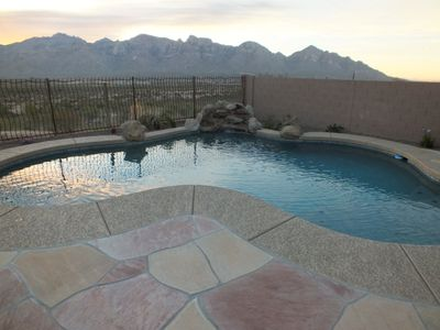Large deck area surrounded pool