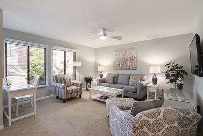 Spacious open living room provides a lot of natural light.