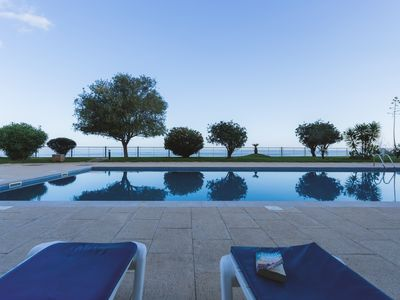 Photo for Baia Cliff View apartment - designer interior, spacious gardens with shared pool