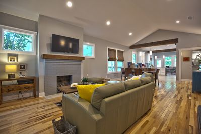 """Living area , 55"""" Ultra HDTV with cable."""