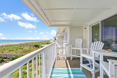 """""""Sea Dolphins"""" covered balcony has beautiful ocean views. 6 high chairs/3 tables"""