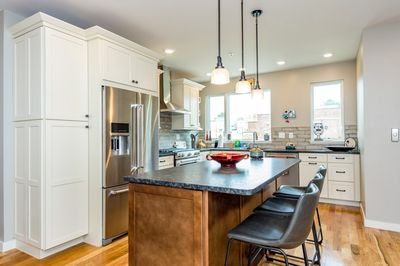Kitchen - The brand-new kitchen boasts granite countertops and stainless steel appliances.