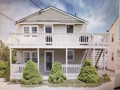 Photo for Completely renovated first floor condo half block from the beach
