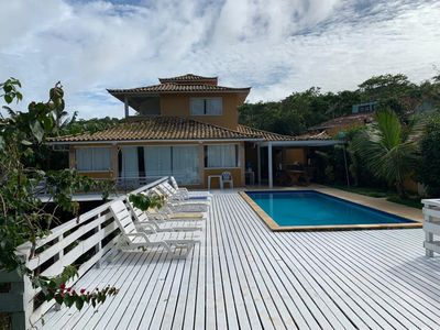 Photo for Ferradurinha - 04 suites w / air, pool, 02 grills and 04 covered spaces.
