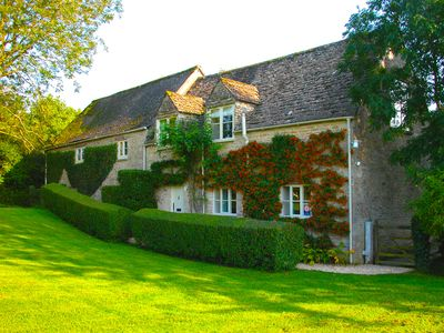 Photo for 4* Cotswold stone cottage on the banks of the River Thames.