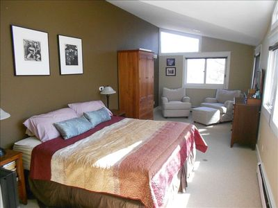Master bedroom with king bed and sitting area. Views of the flatirons from bed!