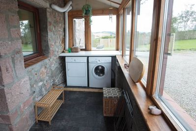 The entrance porch with washing machine and tumble drier
