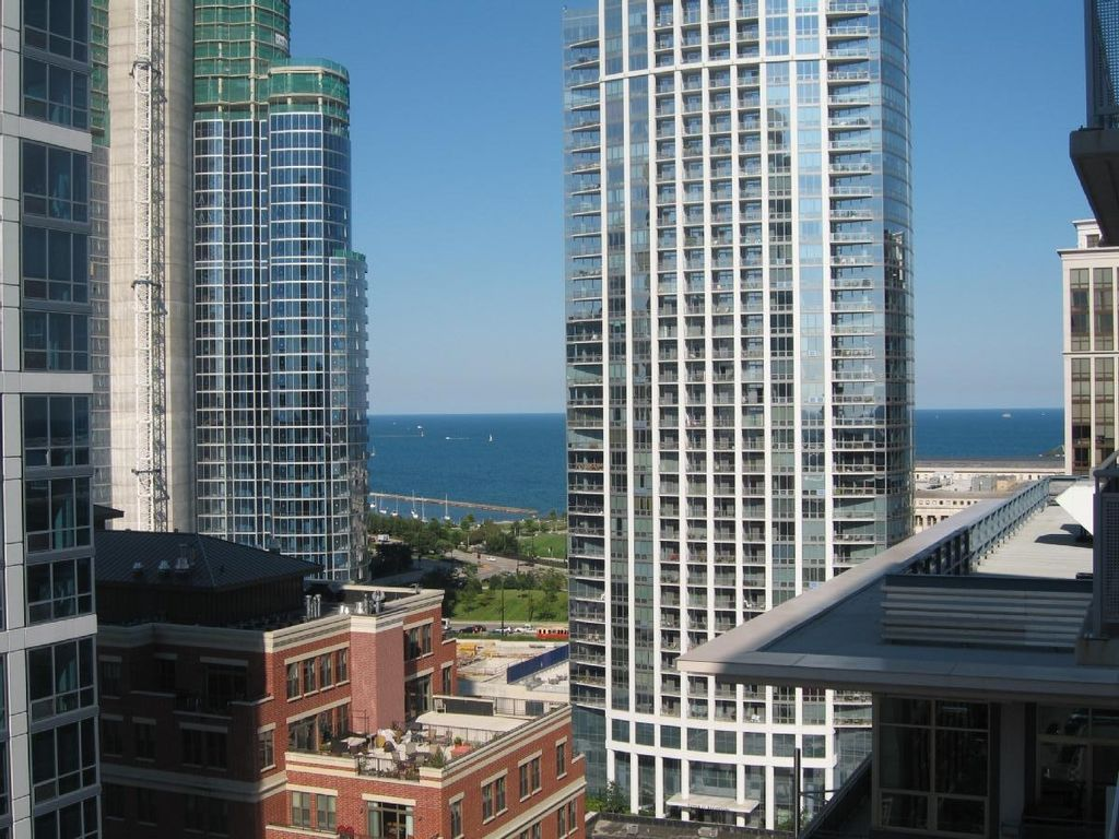 SUPERB Lake and Skyline Views + Luxury Comfort at PRIME Downtown Location!!