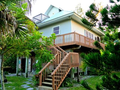 Photo for Old Florida Island Home - high speed internet + golf cart, quiet, private garden