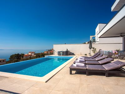 Photo for NEW! Villa Nano, 4 bedrooms, jacuzzi, heated pool, sea views, pebble beach 850m