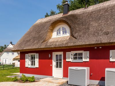 Photo for Lovely, thatched-roof house with premium furnishings, near the beach