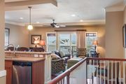 Gilligans: Leather and Hardwoods Throughout Luxurious Oceanfront Condo