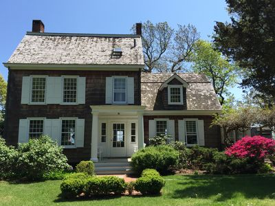 Front view, with welcoming entry, classic, shingle waterfront home