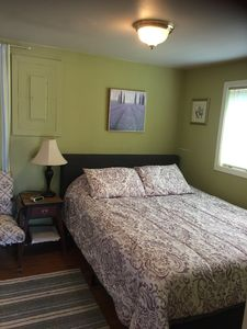 Serene Q bedroom with new bed.