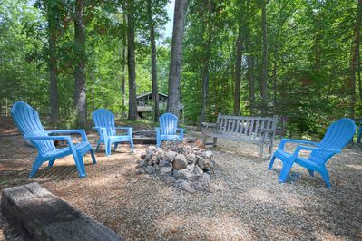Fire Pit and Outdoor Chairs Near to the Shore.
