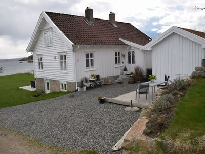 Photo for Beautiful holiday home in Southern Norway - directly on the fjord for 4 persons with private beach
