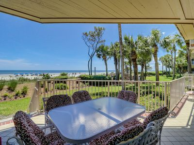 Photo for 1002 Turtle Lane sits directly on the beach with amazing ocean vistas!
