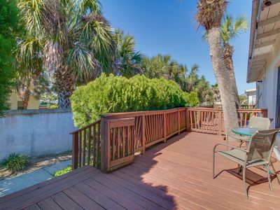 Photo for Cozy duplex with a furnished deck - only a half block from the beach!