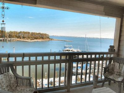 Photo for Bay view three bedroom penthouse in historic district overlooks Manteo Harbor