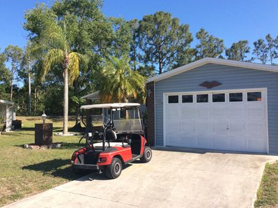 Golf cart included. 1 1/2 car garage fits car and cart very easily.