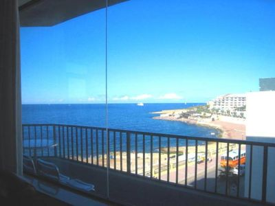 Beach view from 35 m long Seafront Terrace with  outdoor table, chairs, sunbeds