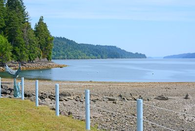 The beach is expansive at low tide, perfect for beachcombing.