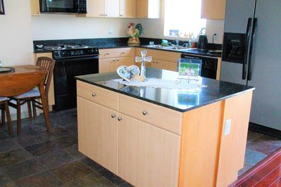 KITCHEN - FEATURES GRANITE COUNTER TOPS, STOVE, OVEN DISHWASHER,  MICROWAVE