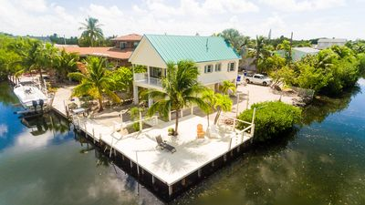 **BEAUTIFUL HOME ON CANAL, W/BOAT RAMP & DOCK, BIKES & KAYAKS**