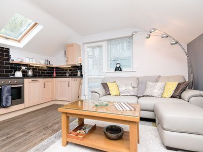 Photo for Modern apartment, short walk from town centre with parking.