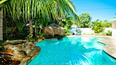 'Private beach entry pool with swim-up tiki cocktail hut, waterfall and gas gril