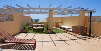 Photo for Fantastic location, 100 meters from the beach and spectacular terrace and solarium