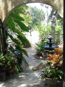 Tropical courtyard with fountain leading to your private entrance