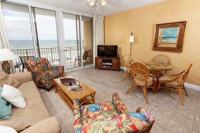 This beach front living room offers unforgettable views of the G - Balcony entry is from the living room.