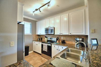 New stainless steel appliances, granite countertop, and beautiful white cabinets