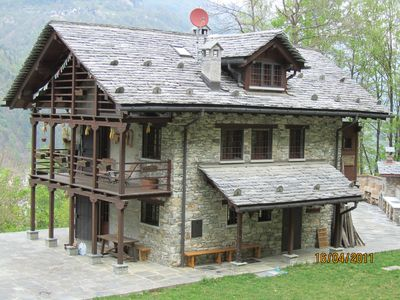 """Photo for A very beautiful chalet in the nature of the forest """"Baita Neva"""""""