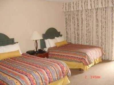 Second bedroom has two Heavenly beds with pillow-top mattress, cable TV.