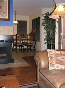 """Relax in the saddle leather sofa, easy chair; enjoy the fireplace & 27"""" TV/DVD"""