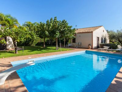 Photo for 4 bedroom Villa, sleeps 5 with Air Con, FREE WiFi and Walk to Beach & Shops