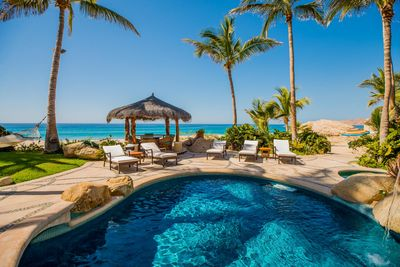 Pool, palapa, seating and view