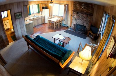 Living and kitchen areas in a 2 bedroom cabin at Antler Ridge