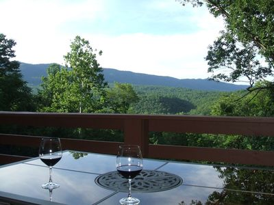 Photo for Stunning view of Mountains, fireplace, hot tub. Comfort is key. River Access