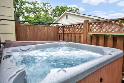 Private hot tub area right off of back door, seats about 6-7