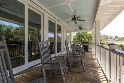 The grill is on the back porch, steps from the kitchen.