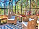 the sunroom is a great place to relax and read a book