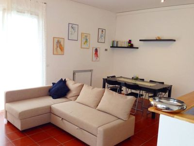 Photo for Torre Del Lago Puccini: Sunny apartment facing a forest, closed to the beach