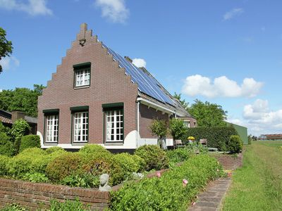 Photo for Characteristic holiday home at the edge of the woods and dune area nearby Egmond aan Zee