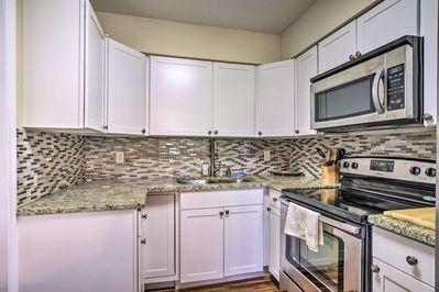 The kitchen comes fully equipped with granite countertops.