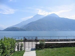 Photo for Apartment with pool, private garden & private boat mooring at shore lake Como