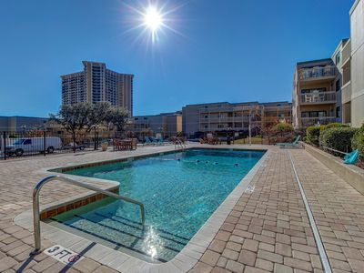 Photo for Spacious snowbird friendly condo w/ shared pools & hot tub - walk to the beach!
