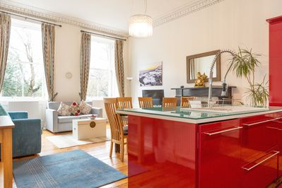 An open plan kitchen, dining and living area.